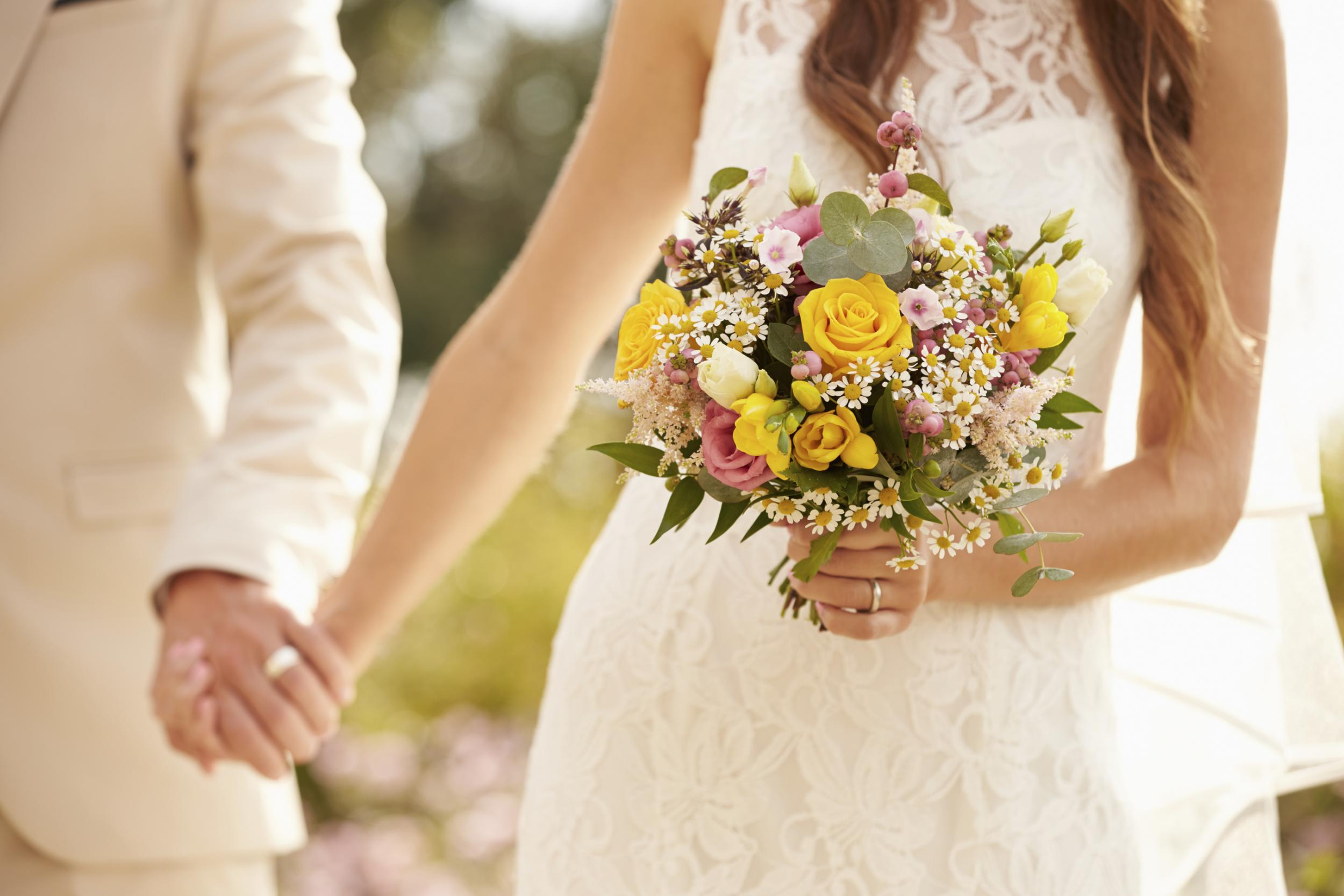 photos/married-couple-bouquet.jpg
